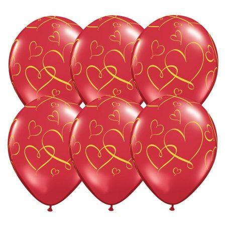 28 cm-es áttetszó piros szívecske mintás gumi lufi, 25 db/csomag